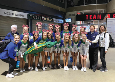 Monica Gaspar, on the far right on the end, head coach for Xavier College Preparatory's Spiritline, recently was named 2019-20 West Section Girls Spirit Coach of the Year. Pictured here are the Spiritline, as well as Sister Lynn Winsor, Xavier vice principal for activities and athletic director, next to Gaspar, Sister Joan Fitzgerald, BVM, president of Xavier, on the end on the far left in the second row, and Dani Behrens, assistant coach, on the end on the far left in the front row (photo by Duke Photography).