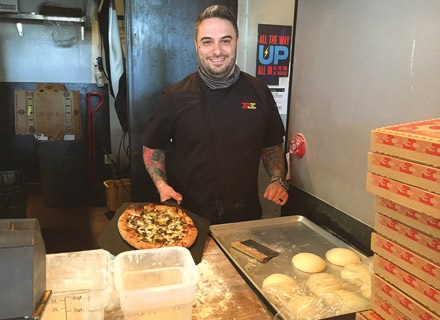 Federal Pizza Chef Eric Ramirez says that biga, an Italian sourdough starter, gives his pizza dough its signature tangy flavor (photo by Marjorie Rice).