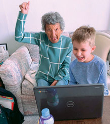 Brody Contreras, a first-grader at Madison Camelview Elementary School, recently danced with his great grandmother, Julia Fulkerson, pictured here. A video of the two of them doing this virtual workout received more than 400,000 views on social media (photo by Angela Groch).