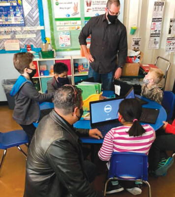 Midtown Primary School recently received support from the Million Dollar Teacher Project, which donated 60 computers and 20 WiFi hotspots to the school (photo courtesy of Midtown Primary School).