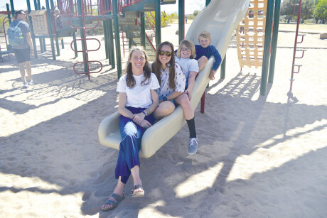 Meredith Russell Francis, in front, her partner Amanda Nieman, and Russell Francis' two sons, Jackson Francis, 12, and Andrew Francis, 9, bond at Granada Park. Russell Francis and Nieman are examples of the growing number of non-traditional mothers and mother figures in North Central and around the country (photo by Colleen Sparks).