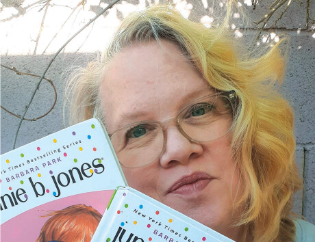 Madison Rose Lane Elementary School received a grant that honors the memory of the author of the popular Junie B. Jones children's books, shown here by Jahnvieve Buseman, a library associate at the school (photo courtesy of the Madison School District).