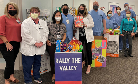 The Abrazo Arizona Heart Hospital staff rallied in June to collect donations of cereal for St. Mary's Food Bank through Abrazo's Healthy Over Hungry Food Drive. The staff donated more than 7,000 servings of cereal to help feed hungry children (submitted photo).