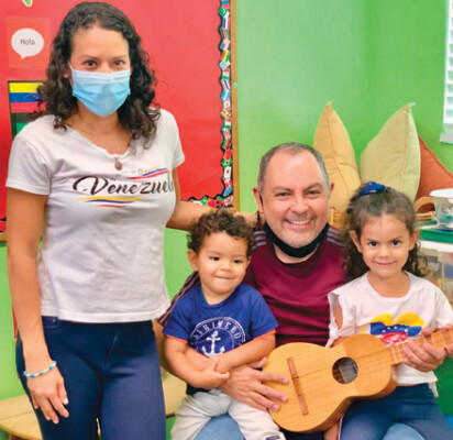 Wife and husband Neudysmar and Jose, along with their children Anthony and Nahomi, participate in a lesson about Venezuela at Phoenix Christian Preschool. Students in the preschool have been exploring different cultures through music, dance, song, eating food and other activities during the summer program (photo courtesy of Phoenix Christian Preschool).