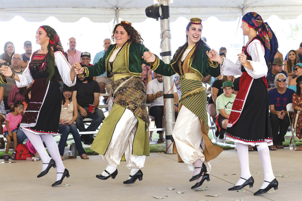 Sophia Scaccia, Eleni Watson, Athena Krestedemas and Anna Fourlis perform a Greek dance at a previous The Original Phoenix Greek Festival at the Holy Trinity Greek Orthodox Cathedral. This large, popular festival will return this year after it was canceled last year due to the COVID-19 pandemic (photo by KGallagher).