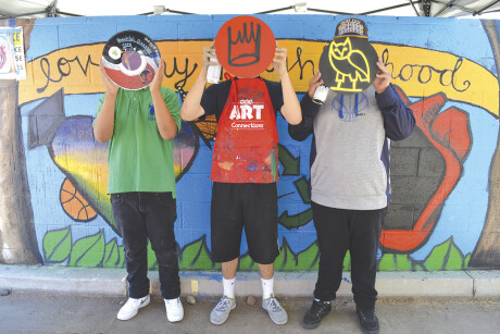 """Youths who participated in a Free Arts for Abused Children of Arizona's Hip Hop Free Arts Day with partner agency Neighborhood Ministries show off the """"records"""" they designed. Free Arts provides arts instruction and activities for youths as ways to help them heal from trauma (photo courtesy of Free Arts for Abused Children of Arizona)."""