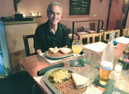 General manager Phil Kelly says the mother sauces – red and green chile – set the tone for the New Mexican-inspired menu at Dick's Hideaway and its sister location, Richardson's. Customer favorites include carne adovada, left, and chile rellenos (photo by Marjorie Rice).