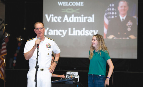"""Vice Admiral Yancy Lindsey, Commander, Navy Installations Command, presented a special """"Challenge Coin"""" to Phoenix Christian junior Hana Marz during a recent visit. Lindsey graduated from Phoenix Christian in 1980 (photo by Sandra Tenuto Photography)."""