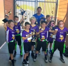 Local youth capture flag football trophy