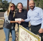 Realtors donate trees to homeowners group