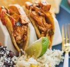 Feast on family meal with tacos, beans, guacamole