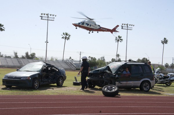 Phoenix Firebird 10, a rescue helicopter owned and operated cooperatively by the Phoenix Fire and Police departments, prepares to land on the football field at Central High School.