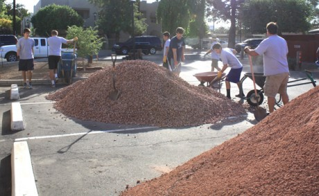 Volunteers from Boys Team Charity North Valley Chapter Class of 2013 prepare piles of gravel to freshen up the landscape at Civitan House in North Central Phoenix (submitted photo).