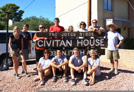 Volunteers pose with the Civitan House sign after a long day of volunteer labor (submitted photos).