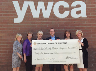 Celebrating the $25,000 grant presentation from the National Bank of Arizona (NB|AZ), are, from left: Pamela O'Keefe and Kathleen Pechman of NB|AZ; Dana Campbell Saylor, chief executive officer of the YWCA Maricopa County; and NB|AZ representatives Jathan Segur, Catherine Arvizu, and Deborah Bateman (submitted photo).