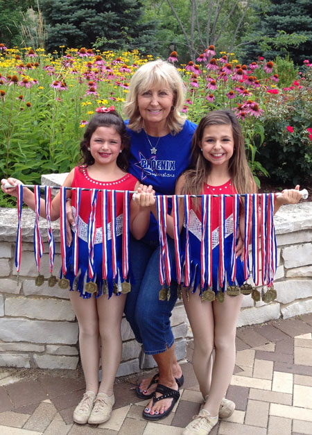 North Central resident Becky Hewitt, who is the head coach for the Phoenix Superstar Twirling Team, took her two young granddaughters to this year's 68th Annual World Open Baton Twirling Championships. Madysin Hewitt, left, age 6, won three medals in her solo events, and sister Alaina, 9, won six individual medals in her solo events (photo courtesy of Becky Hewitt).