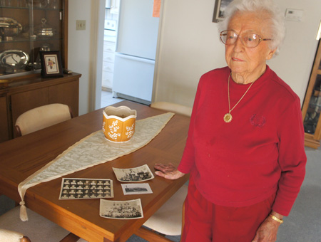 Berta Antrim, 97, recalls attending the first Madison School when she was just 8 years old. She still has her class photos from much of her time with Madison, and is looking forward to the first Madison Schools Alumni Mixer on Nov. 12 (photo by Teri Carnicelli).