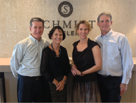 Brothers Tom (left) and Tim Schmitt, along with their wives Erin (left) and Ginnie, continue the tradition of selling fine jewelry established by their parents, Larry and Marie Schmitt (photo by Megan Schmitt).