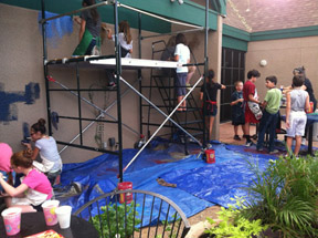 Students from Madison No. 1's National Junior Arts Society paint a mural on a wall in the Tea Garden at Duck and Decanter (submitted photo).