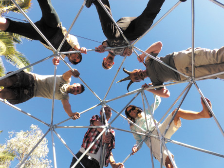 Local inventor Brian Korsedal and a crew of volunteers sprawl on a structure they assembled at the Maker House in Tucson. Clockwise from the top are: Brandon Mason, unknown masked volunteer, Lori Carroll, Dan Reese, inventor Brian Korsedal and Inci Erdem (submitted photo).