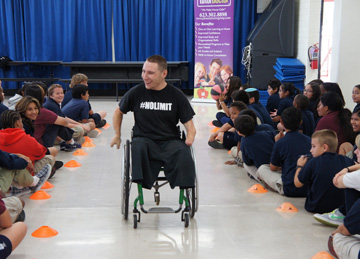 "Wheelchair basketball star and motivational speaker Shayne Smith speaks with students at AmeriSchools Academy as part of ""The Why Factor"" community outreach program, sponsored by Tutor Doctor (photo by Teri Carnicelli)."