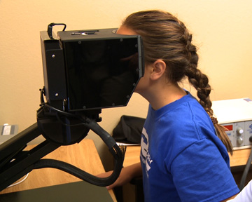 Dana Day, an audiologist, assesses the oculomotor functions of a soccer player with the Phoenix Rush club. The test, known as videonystagmography or VNG, is part of the advanced technology CACTIS provides at the Banner Concussion Center in Phoenix (submitted photo).