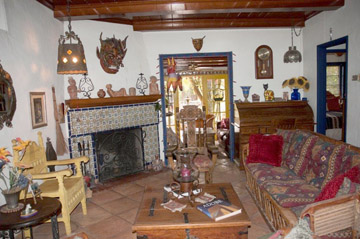 Built in 1937, this adobe home in the historic Del Norte Place neighborhood has a decidedly Mexican style. The Talavera tile in nearly every room—installed by the homeowner—that gives the home its true flavor, enhanced by ceramic figurines, dramatic art masks, and a tiled fireplace. Outside, a Mexican fountain from Guadalajara, a pond, and a sunken spa turn the backyard into a hidden oasis with a south of the border feeling (submitted photo).