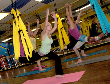 One of the hottest new trends in exercise is aerial yoga, which is being taught once a week at the new Fit'N Lean studio on 16th Street just north of Bethany Home Road (photo by Teri Carnicelli).