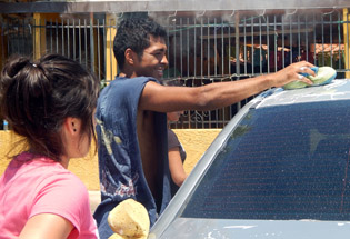 Local boxer Angel Baltazar gets some help washing cars as part of a fundraiser for his boxing gym, the Chavez Boxing Foundation, at 7th and Missouri avenues. Another car wash fundraiser is coming up on March 29 (submitted photo).