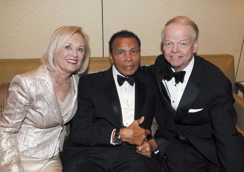 Nancy Walker, Celebrity Fight Nigh Foundation board member, and her husband Jimmy Walker, longtime North Central resident and founder of Celebrity Fight Night, visit with boxing legend Muhammad Ali at a previous event (submitted photo).