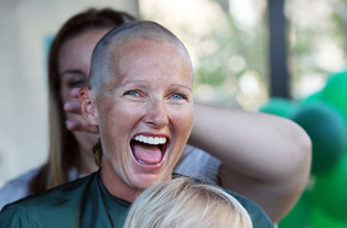 An unidentified woman has her head shaved to help raise money for childhood cancer research, as part of an annual event hosted by the St. Baldrick's Foundation (submitted photo).