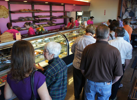 Karl's Bakery had steady crowds on its opening day, April 1, and had sold out of most of its tasty treats by noon (photo by Teri Carnicelli).