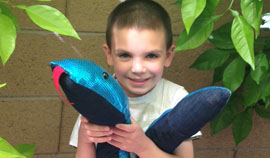 North Central youth Declan Mancilla holds a Weighted Boa Snake, one of the new children's therapy products introduced by local art therapy business, Artplay (submitted photo).
