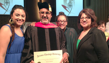 The Rev. Richard Caballero, pastor of Longview Community Church in Phoenix, celebrates his honorary doctorate with his family, from left: daughter Natalie, wife Leonor, and daughter Melissa (submitted photo).