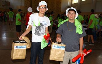 Camp Courage 2014 attendees Emmanuel Serrano, left, and Jonathon Valenzuela pick up their swag on the first day of camp, including a free pair of new athletic shoes donated by Kitchell (photo by Rick Apple).