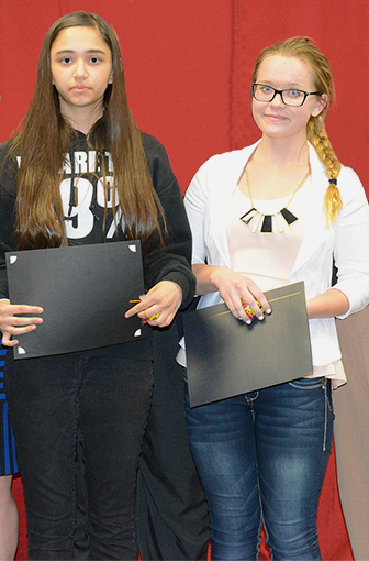 Receiving certificates and cash awards for their winning entries in the 2014 Anti-Defamation League of Arizona's Echoes and Reflections Moral Courage Essay contest are, from left, Anjali Moore of Madison Meadows, and Becca Webb of Madison No. 1 (photo courtesy of the Madison School District).
