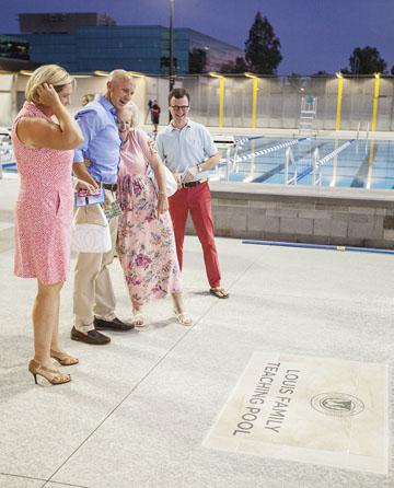 "From left: Amy and Tim Louis view the ""Louis Family Teaching Pool"" marker located on the ground adjacent to the new pool at the Phoenix Country Day School Aquatic and Tennis Center, along with Gay Wray, a founder of the school, and C. Ryan Joyce, PCDS's director of Advancement (photo by Largo Photography)."