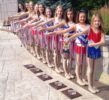 Pictured with their winning plaques and medals are the 10 members of the Phoenix Superstar Twirling Team, trained by longtime North Central resident Becky Hewitt (submitted photo).