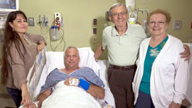 Edward Cerninka, (second from left) who is he first Phoenix Baptist Hospital patient to use the new NICO BrainPath technology, was joking with his family less than 24 hours after his brain tumor was removed. Also pictured are Stacey Cerninka, Edward's wife; and his parents, Edward Cerninka Sr. and Rose Marie Cerninka (photo courtesy of Abrazo Health).