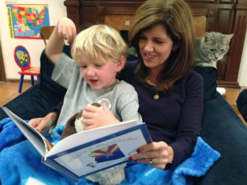 """Jennifer Hecker DuVal reads her new children's book, """"Monte and the Magnificent Star,"""" to the inspiration of the book—her 6-year-old son, Monte—while Vanilla the cat looks on (submitted photo)."""