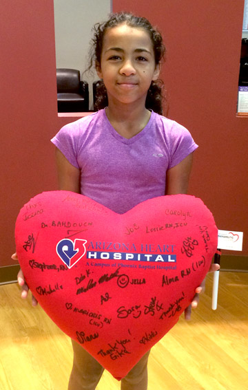 North Central youth Audra Sims received a heart-shaped pillow signed by Arizona Heart Hospital staffers in appreciation of her fundraising effort (submitted photo).