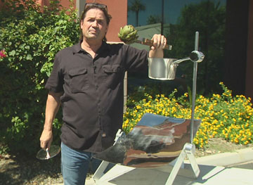 North Central resident Dave Thompson shows how his invention, the Sol-Man Solar Cooker, can be used outdoors for cooking food, including a nice large artichoke (submitted photo).