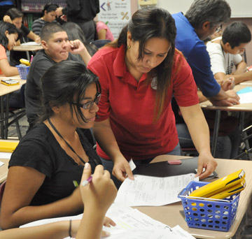"Erika Parra, a math teacher at Metro Tech High School, recently was selected as a 2014 Chicanos Por La Causa Esperanza Award winner. According to Metro Tech counselor Dora Villa, who nominated Parra for the award, ""Students can find her in her room ready to tutor during her own lunch hour, after school and even on Saturdays. They are not afraid to ask for help, and they appreciate how she encourages them."" (submitted photo)."