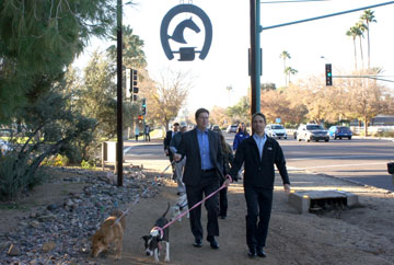 Phoenix Mayor Greg Stanton is joined by Dr. Steven Hansen, president and CEO of the Arizona Humane Society, as they walk two of the Sunnyslope Shelter's dogs along the Murphy Bridle Path as part of the Jan. 15 launch of AHS's new shelter dog-walking program. Stanton is walking Yogi, who was heading to his new forever home later that morning, and Hansen is walking Mona Rose, a young boxer mix who was found as a stray and is very good with other dogs (photo by Teri Carnicelli).