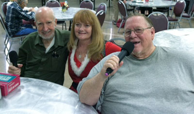 Enjoying some karaoke at the Sunnyslope Senior Center are, from left: Jim Wahl, entertainer Kristina O'Boyle, and Carey Mavor (submitted photo).