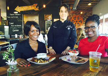 Jewel's Bakery & Café owner Julie Moreno chats with Dr's. DeJarra K. Sims and Paula Stewart, both naturopaths, who enjoy a Classic Breakfast Platter and a Breakfast Parfait after hiking (photo by Patty Talahongva).