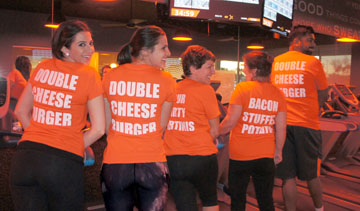 Celebrating the grand opening of the Orangetheory Fitness studio at 7th Street and Glendale Avenue and wearing some fun promotional T-shirts created for the event are members, from left: Theresa Herro, Courtney Vittoria, Karen Wood, Marianne Watts, and Anuj Bhatnagar (photo by Teri Carnicelli).