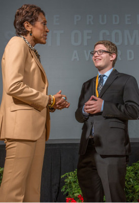 "North Central teen Matthew Kaplan receives a personal congratulations from ""Good Morning America"" co-anchor Robin Roberts at an award ceremony and gala dinner reception held in May at the Smithsonian's National Museum of Natural History in Washington, D.C. (photo by Zach Harrison Photography)."