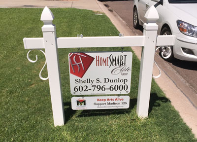 """Shelly Dunlop with HomeSmart Elite Group not only started adding the riders """"Keep Arts Alive. Support Madison 125"""" on all her for-sale signs in the North Central community, she also is offering them for free to any other real estate agents in the area who want to support the Madison Education Foundation (submitted photo)."""