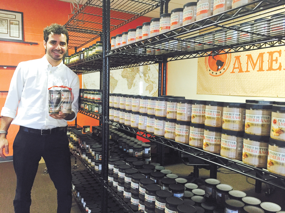 Jeff Malkoon, owner of Peanut Butter Americano, holds a sample four-pack of jars, which is a great option for people who want to break up the set to give to various friends or family members as holiday or hostess gifts (photo by Patty Talahongva).